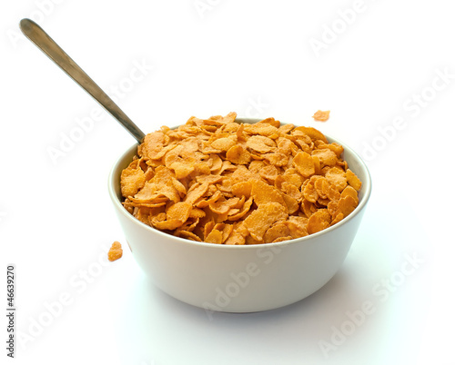 Bowl of corn flake cereal with a spoon