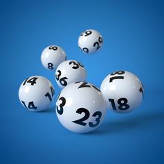 6 Lottokugeln rollen auf blauem Hintergrund