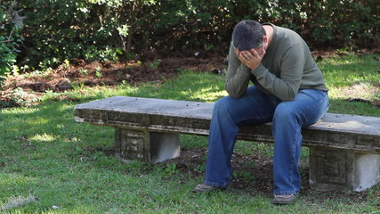 Depressed Man On Bench