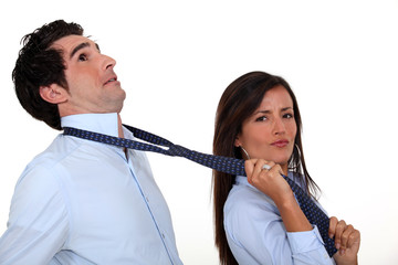 Woman pulling on boyfriend's tie