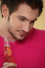 Man holding bottle of beer