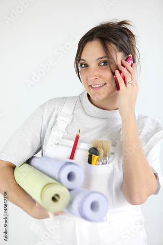 Portrait of woman paperhanger on the phone