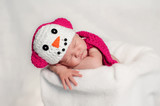 Newborn Baby Girl Wearing a Pink Snowgirl Costume