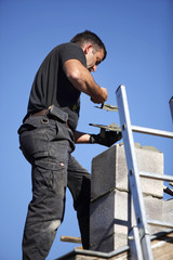 Roofer making a chimney stack