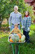 Happy  family with harvested pumpkins