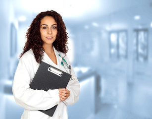 Doctor woman with a clipboard in the hospital