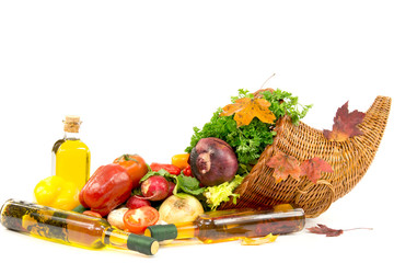 Group of different vegetables, olive oil and autumn cornucopia