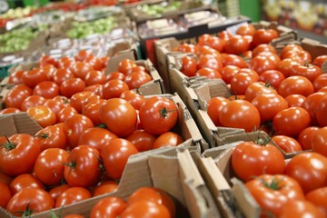 Boxes with red tomatoes for sale in grocery