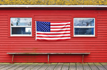 Patriotic flag on old wooden wall