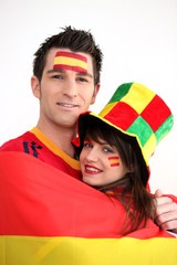 Couple supporting the Spanish football team