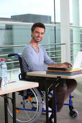 Man on laptop in wheelchair