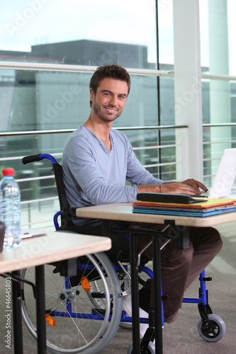 Man on laptop in wheelchair