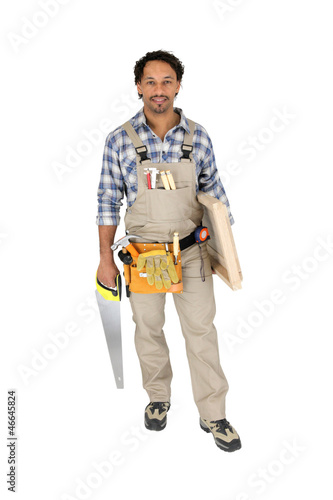 Carpenter holding door and saw