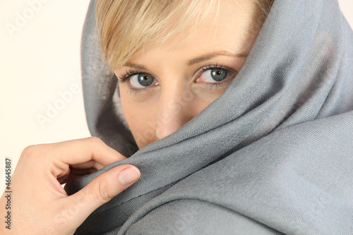 close-up of a woman face wearing a headkerchief