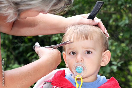hair cutting first one-year-old child - trimming bangs