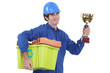 Bricklayer with award for recycling