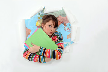 female student with map of the world in background