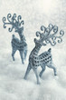 Christmas card. two deers on a snowy background