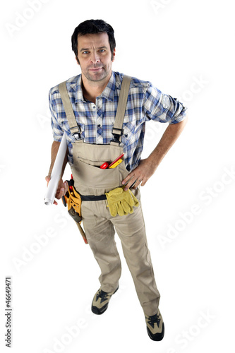 Workman with rolled up plans