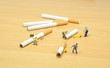 Stop smoking concept with workmen getting rid of cigarettes