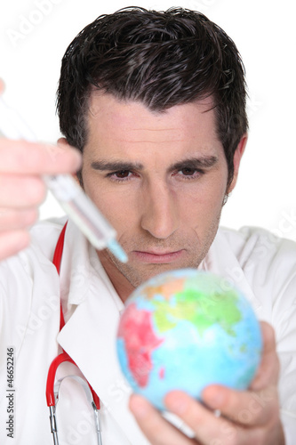 Doctor using syringe on a globe