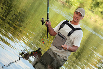 Oblique image of a fisherman on a river