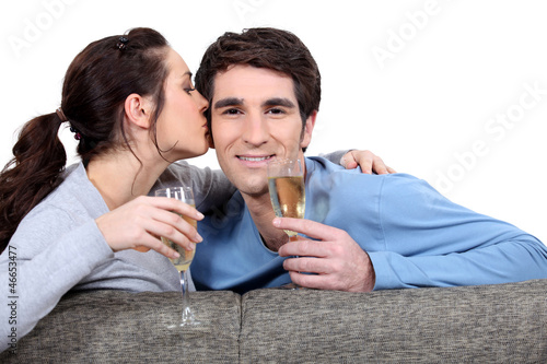 Couple with champagne glasses kissing