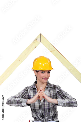 Woman stood by wooden framework