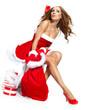 Portrait of a beautiful woman wearing a santa costume