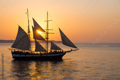 canvas print picture A sailing ship at sunset