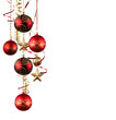 Bright red Christmas tree balls with curly ribbons isolated on t