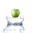 Green apple splashing into water.