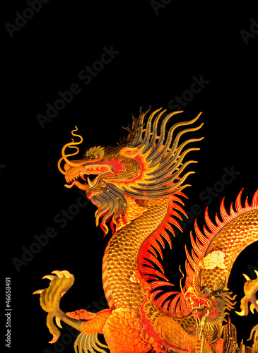 Chinese style dragon statue isolated on black background.
