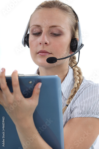 Call centre agent writing on a clipboard