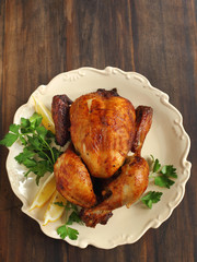 Roast chicken seasoned  with herbs and lemon