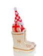 Christmas gifts in children's boots isolated over white