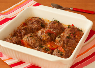 meatballs with vegetables in white pan