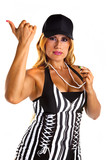 "Sexy woman referee  signalling ""you are out"" isolated on white."