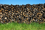 Woodpile with a meadow poster