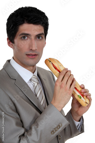 Businessman eating a sandwich