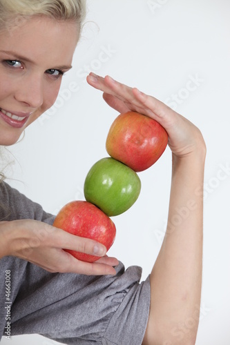 young woman holding apples