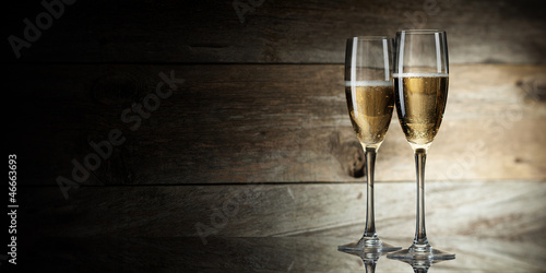 two glass with champagne on a wooden background - 46663693