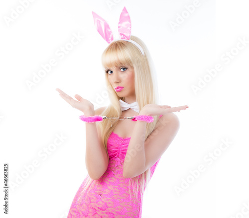 Pretty woman in bunny ears with handcuffs