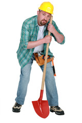 craftsman looking tired with whovel isolated on white