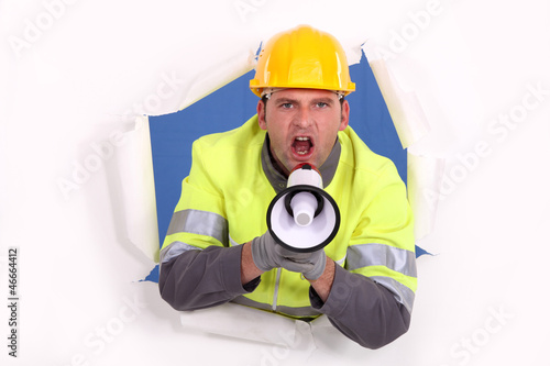 road worker yelling in a megaphone
