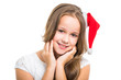 beautiful girl with red Christmas cap on isolated white