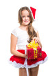 girl with red Christmas cap and present on isolated white