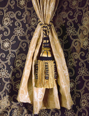 great design of fabric and tassel on the fabric background