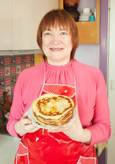woman with cooked pancake