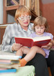 grandmother and child reading  book together